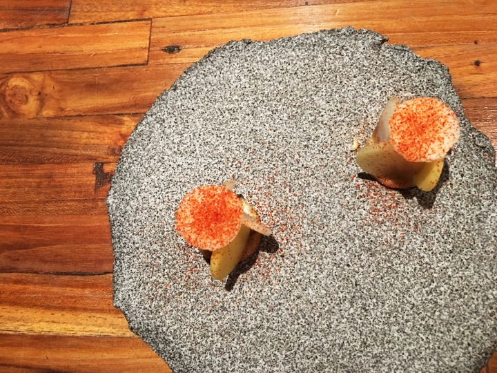 """Amuse Bouche: Candied young fruit with ginger and cashew nut gel with chilli powder. Restaurant Locavore's version of a """"rojak""""."""